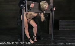 Blonde strugging in chains and stocks