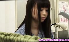 Sexy petite Japanese babe undresses