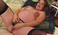 Mom toys her pregnant pussy