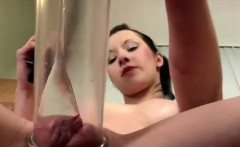 Horny brunette masturbates with pump and pisses in close-up