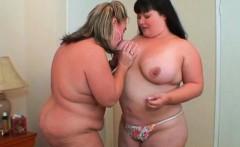 Lesbo BBW couple licking big hot boobs