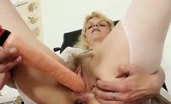 Strange gramma opens her hirsute pussy with a pussy-spreader