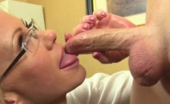 Mature businesswoman with bigtits tugging on cock