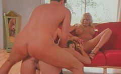 Blonde and brunette share cock in a threeway