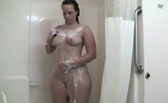 plump girl washing her body in the shower
