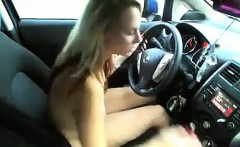 Slut masturbates and strips while driving