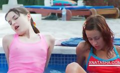 Lesbian lovers playing naked in pool