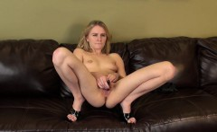 Blonde Kelly Klass toys her twat on the couch and watches her webcam
