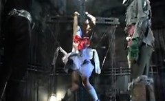Foxy sex slave is strung up and undressed so he can grab he