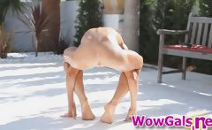 Super skinny and oiled up teen performs flexible acrobatics