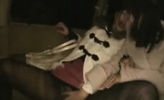 Two pretty and lustful Japanese girls passionately kissing