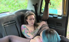 Inked lesbians tribbing to orgasm in fake cab