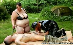 Plump dominas take their subject for a walk in the park