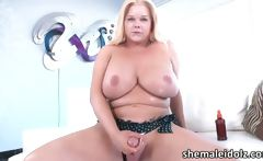 Massive boobs shemale blonde Holly Sweet cums after strokin