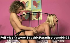 Naughty lesbos toying pussy with a strapon and having lesbo