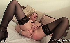 Blonde mature in hot ass masturbating pussy with fingers