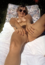 Yvonne naked on the lawn