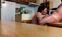 Cock sucking on the kitchen table