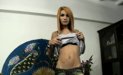 Redhead ladyboy undresses and wanks off her shecock
