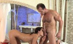 Masseur eats oiled busty brunette babe