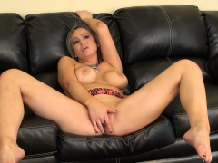 Voluptuous blonde Abbey Brooks takes herself to pleasure on the couch