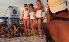 Sexy gals are on the beach and competing in a wet T-shirt c