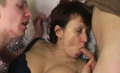 Two guys experiencing attractive mature milf during sex