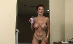A handjob is given by sexy mother