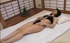 Enticing Oriental wife gets pleased with a vibrator and blo