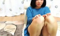 Pretty Oriental girl uses her favorite toy to please her sh