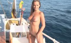 Brunette bombshell shows off on the boat