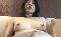 Horny mature rubs her hairy twat