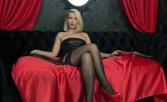 Blonde milf fingering her wet pussy in black stockings