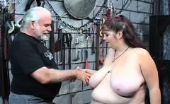 Bare woman stands and endures rough bondage amateur