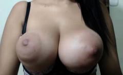 A super sexy brunette massages her big boobs