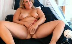 chubby blonde girl fucks herself with a big dildo