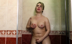 Blond Tranny Stokes Her Hard Cock in the Shower
