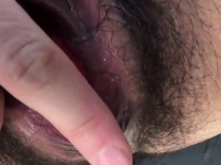 Asian touches her pussy