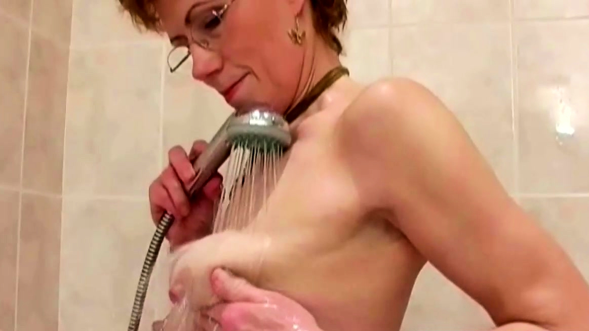 Mature Redhead Taking A Hot Shower