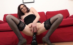 Horny mature brunette gets the BBC to cum on her face