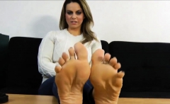 Hot brunette enjoys foot fetish