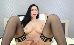 Sexy big tits brunette MILF camgirl in stockings on webcam