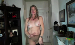 American milf Rebecca Nollan toys her nyloned pussy