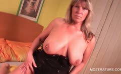 Mature sex addict blonde working her tits and cunt in bed