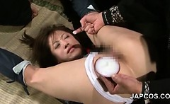 Mature asian slut in ropes cunt fucked with a stick in group